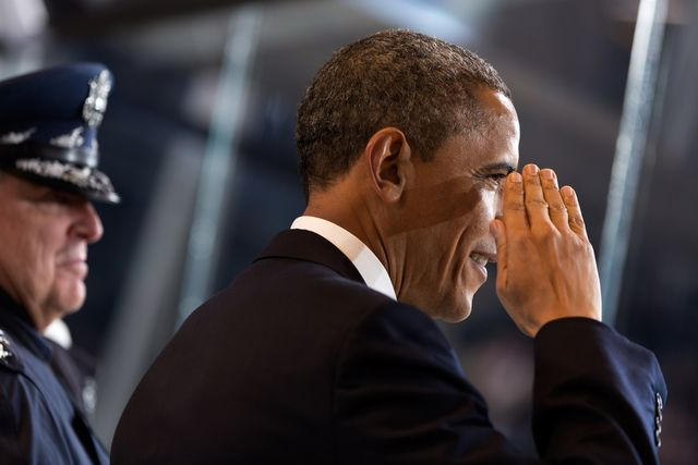 President Barack Obama salutes military service members while watching the inaugural parade from the reviewing stand on Pennsylvania Avenue in Washington, D.C., Jan. 21, 2013. (Official White House Photo by Pete Souza)