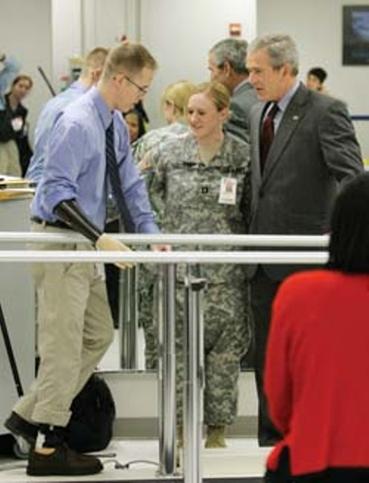President George W. Bush and Dora watch as Scott demonstrates exercises at Walter Reed