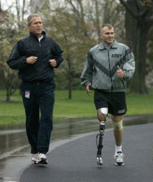Sgt. Mike McNaughton running with President Bush at the White House