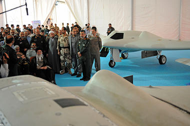 American drone in forefront, Iran's drone in background