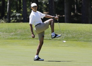 U.S. President Obama reacts after missing putt on the first green at golf course on Martha's Vineyard