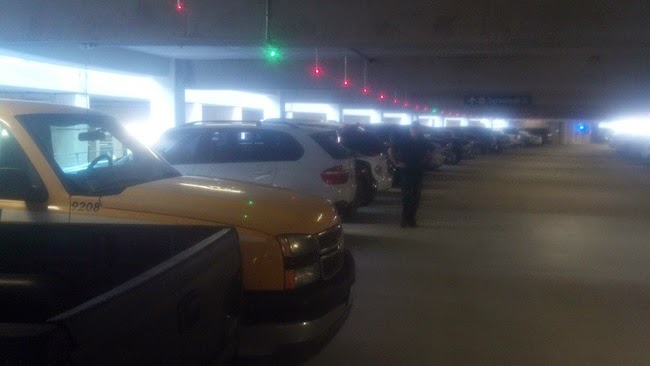 parking garages with lights showing open spaces