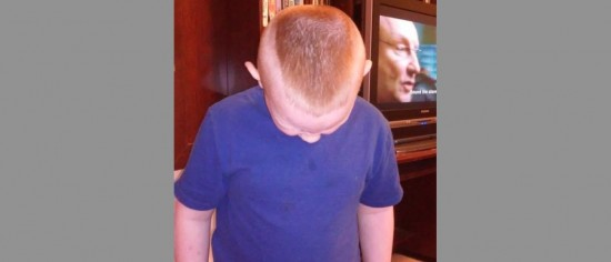 7 year old forced to shave head