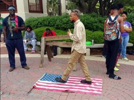 black supremacist eric sheppard desecrating the American flag1