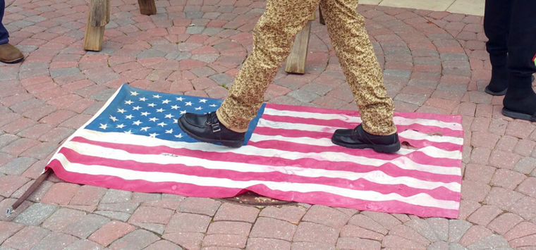 black supremacist eric sheppard desecrating the American flag2